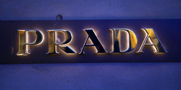 A logo sits outside a Prada SpA luxury clothing store in Frankfurt, Germany, on Monday, Nov. 11, 2013. As the euro area strug