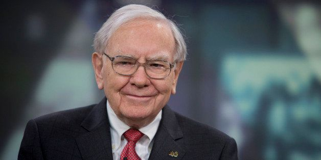 Warren Buffett, chairman and chief executive officer of Berkshire Hathaway Inc., smiles during an interview in New York, U.S.
