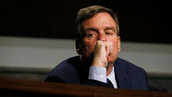 Senate Intelligence Committee Vice Chairman Senator Mark Warner listens to testimony from Twitter CEO Jack Dorsey and Facebook COO Sheryl Sandberg at a hearing on foreign influence operations on social media platforms on Capitol Hill in Washington, U.S., September 5, 2018. REUTERS/Jim Bourg