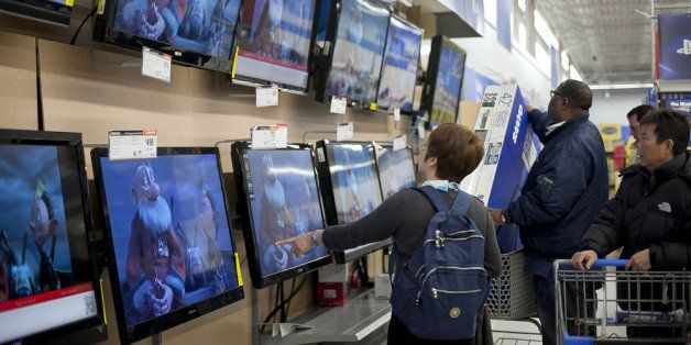QUINCY, MA - NOVEMBER 23:  Shoppers look at televisions at Walmart during the Black Friday sales on November 23, 2012 in Quin