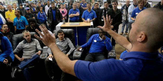 DENVER, CO. - NOVEMBER 23: General Manager Doug Ryan, right, prepares his staff for a Black Friday rehearsal at Best Buy in D