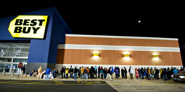 Shoppers wait in line outside a Best Buy Co. store prior to the store's midnight opening in Peoria, Illinois, U.S., on Thursd