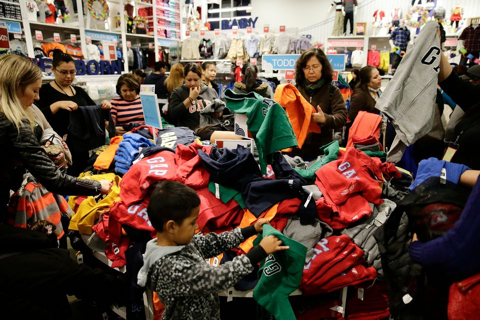 People shop at a Gap factory store at the Citadel Outlets on Thursday, Nov. 28, 2013, in Los Angeles . Instead of waiting for
