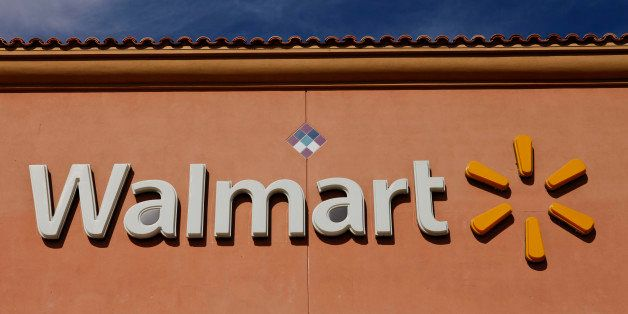 Wal-Mart Stores Inc. signage is displayed outside of a location ahead of Black Friday in Los Angeles, California, U.S., on Tu
