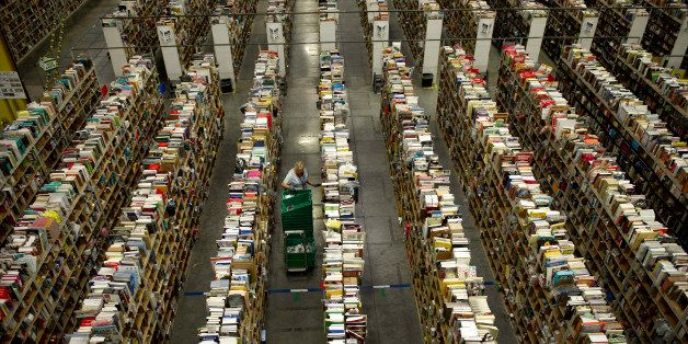 An employee stows items at the Amazon.com Inc. fulfillment center in Phoenix, Arizona, U.S. on, Sunday, Dec. 1, 2013. More th