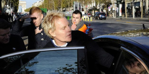 US Mike Jeffries, CEO of US clothing retailer Abercrombie & Fitch leaves the store on the Champs Elysees avenue in Paris on O