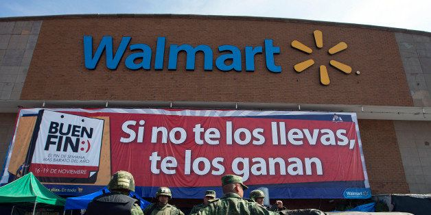 Soldiers drive past a Wal-Mart de Mexico SAB de CV store in Mexico City, Mexico on Saturday, Nov. 17, 2012. El Buen Fin, Mexi