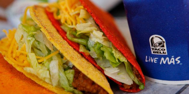 Doritos Locos tacos and a fountain drink are arranged for a photograph at a Taco Bell restaurant, a unit of Yum! Brands Inc.,