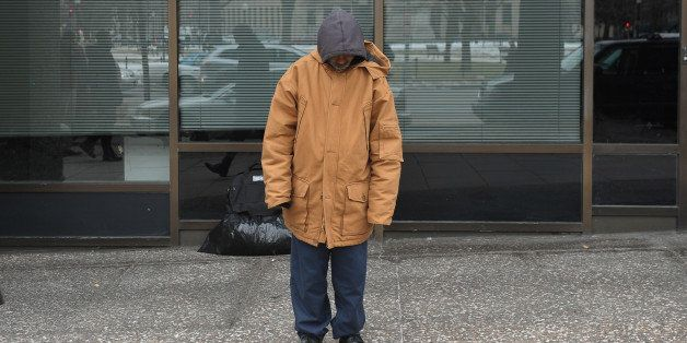 TO GO WITH AFP STORY by Joseph Krauss, US-poverty-homelessA homeless man stands in front of his belongings January 31, 2011 o