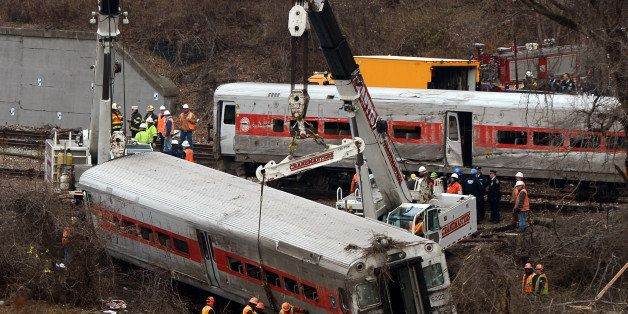 NEW YORK, NY - DECEMBER 2 :  Cranes lift the derailed train wagons near the Spuyteh Duyvil station on December 2, 2013 in New