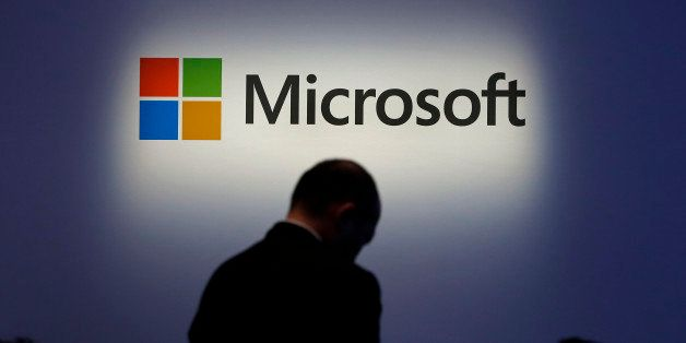 The Microsoft Corp. logo is displayed at a launch event for the company's Windows 8.1 operating system in Tokyo, Japan, on Fr