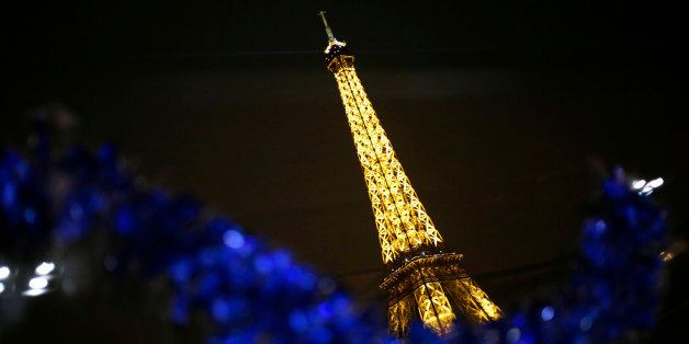 Photo taken on December 24, 2013 shows the Eiffel Tower in Paris. AFP PHOTO / KENZO TRIBOUILLARD        (Photo credit should
