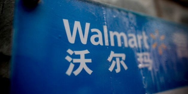 Signage for Wal-Mart Stores Inc. is displayed at one of the company's stores in the Luohu district of Shenzhen, China, on Tue