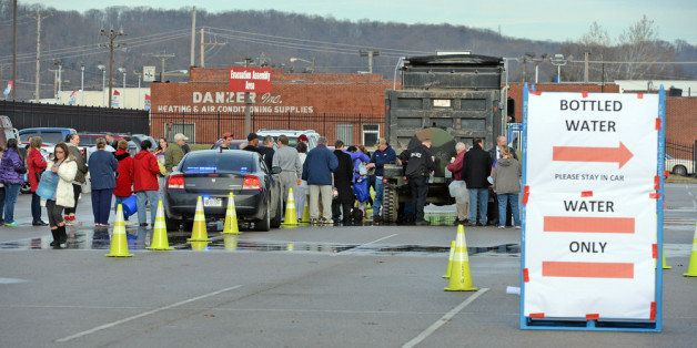 SOUTH CHARLESTON, WV - JANUARY 10:  West Virginia American Water customers line up for water at the Gestamp Plant after waiti