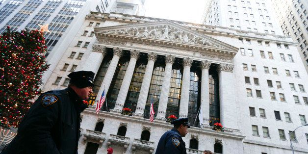 New York City police officers walk past the New York Stock Exchange (NYSE)  in New York, U.S., on Friday, Dec. 27, 2013. U.S.