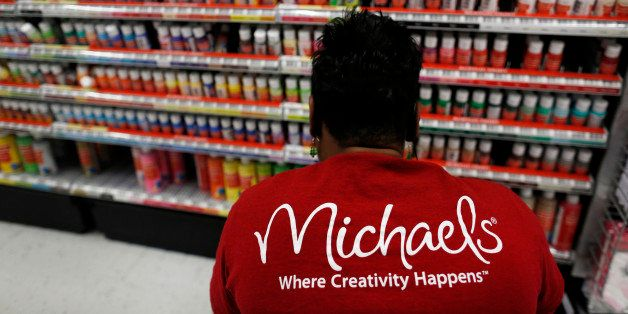 Employee Nikki Bush stocks acrylic paint at a Michaels Stores Inc. location in Cincinnati, Ohio, U.S., on Monday, Dec. 9, 201