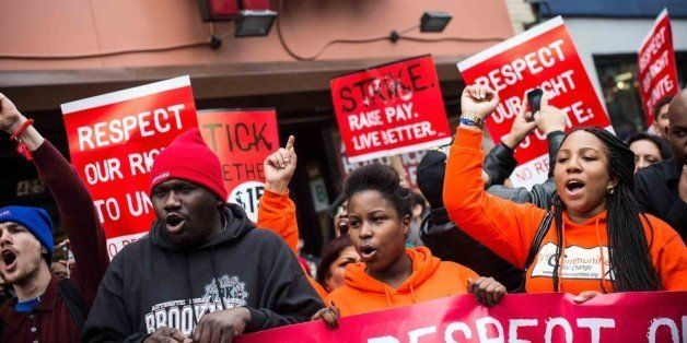 NEW YORK, NY - DECEMBER 05:  Protesters rally outside of a Wendy's in support of raising fast food wages from $7.25 per hour