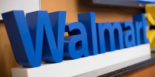 The Wal-Mart Stores Inc. logo is displayed during a media briefing with Scott Price, chief executive officer for Asia at Wal-