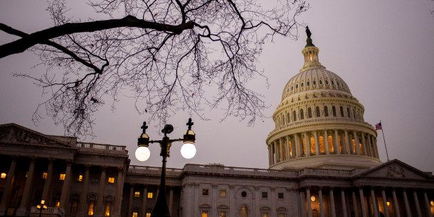 The Capitol building stands at dusk before U.S. President Barack Obama delivers the State of the Union address to a joint ses