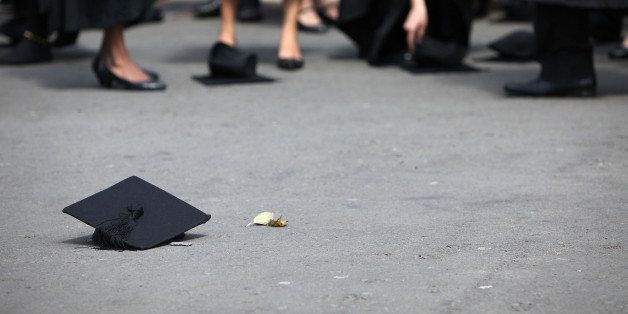 BIRMINGHAM, ENGLAND - JULY 14:  Students pick up their mortarboards after the offical hat throwing photograph at the Universi