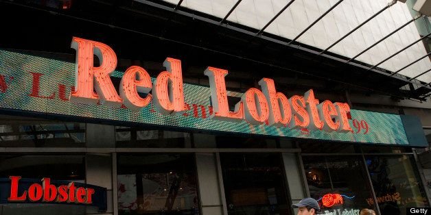 Pedestrians pass a Red Lobster restaurant in Times Square, New York, U.S., on Tuesday, March 23, 2010. Darden Restaurants Inc