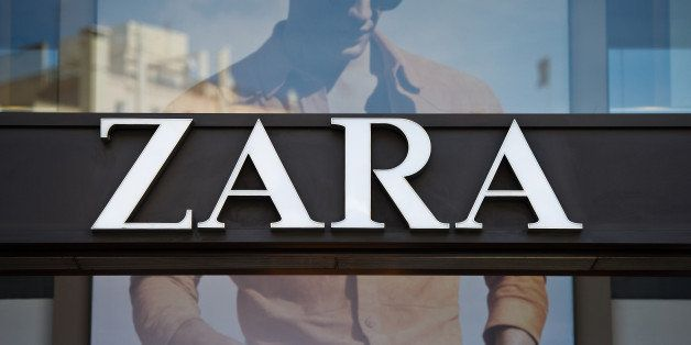 A logo sits on display above the entrance to a Zara retail store, operated by Inditex SA, in Barcelona, Spain, on Tuesday, Ap