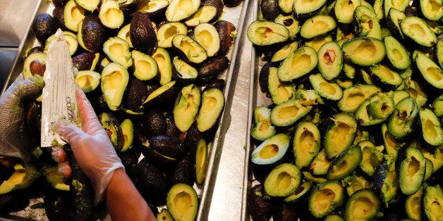 An employee slices avocados to be made into fresh guacamole at a Chipotle Mexican Grill Inc. restaurant in Hollywood, Califor