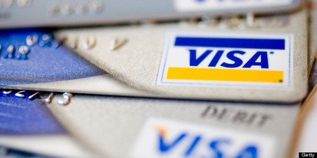 UNITED STATES - JULY 30:  Visa logos appear on credit and debit cards arranged for a photograph in New York, U.S., on Thursda