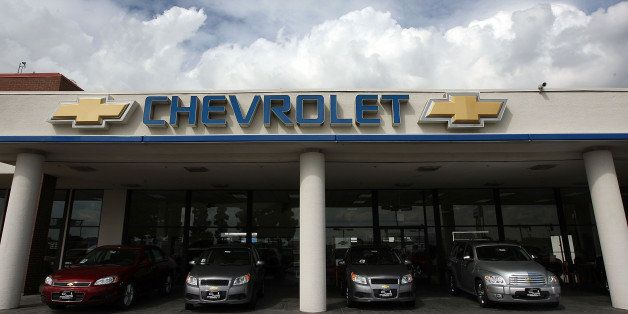 MONROVIA, CA - MARCH 2:  General Motors cars are displayed at the Sierra Chevrolet auto dealership as storm clouds build in t