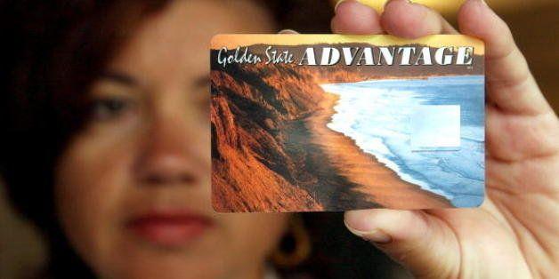 OAKLAND, CA - JULY 17:  Deborah McFadden holds a sample of the new California State Electronic Benefit Transfer (EBT) card Ju