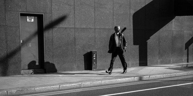 [UNVERIFIED CONTENT] A decisive moment and slightly surreal image of a man walking distractedly down a sunlit street whose wa