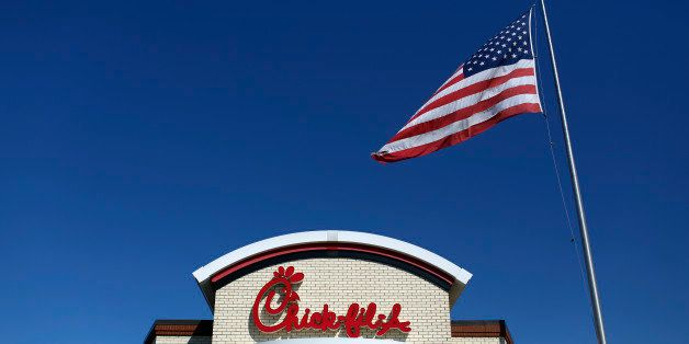 A U.S. flag flies outside a Chick-fil-A Inc. restaurant in Bowling Green, Kentucky, U.S., on Tuesday, Mar. 25, 2014. The U.S.