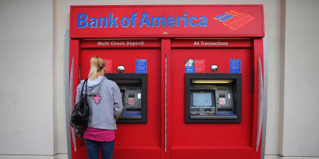 MIAMI, FL - JANUARY 17:  A customer uses a Bank of America ATM machine on January 17, 2013 in Miami, Florida. The bank report
