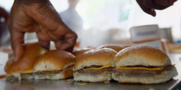 WASHINGTON, DC - JUNE 14:  White Castle employees cook their slider burgers before delivering them at the U.S. Capitol to cel