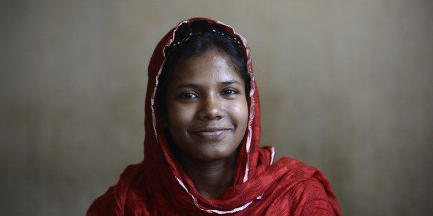 In this photograph taken on April 23, 2014, Bangladeshi garment worker Reshma Akter, who rescued after 17 days from the rubbl
