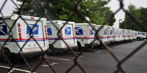 (FILES)US Postal Service mail delivery trucks sit idle at the Manassas Post Office in Virginia on September 5, 2011.The US Po