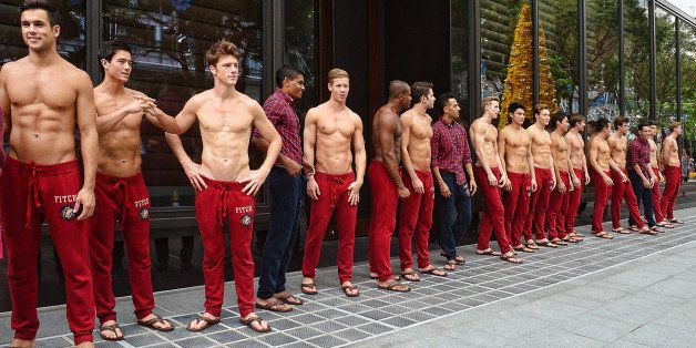 The shirtless Abercrombie and Fitch models posed in front of the American fashion chain's flagship store at Kightsbridge, Orc