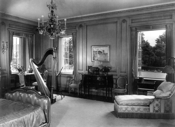Huguette's mother Anna's bedroom in about 1940 at Bellosguardo in Santa Barbara. A painting by Sargent hangs next to the wind