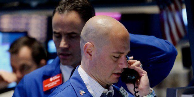 Stock specialists at the Barclays post work on the floor of the New York Stock Exchange just before the opening bell May 13,