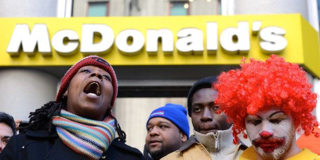 NEW YORK, UNITED STATES - MARCH 19: Fast-food workers calling for better wages demonstrate outside a McDonald's restaurant on