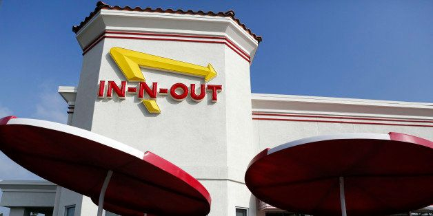 Customers enter an In-N-Out Burger restaurant in Costa Mesa, California, U.S., on Wednesday, Feb. 6, 2013. In-N-Out, with alm