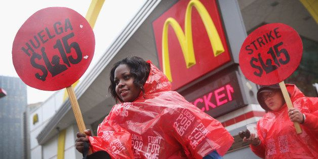 CHICAGO, IL - MAY 15:  Fast food workers and activists demonstrate outside McDonald's downtown flagship restaurant on May 15,