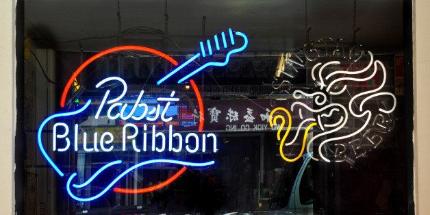 SAN FRANCISCO, CA - MAY 13, 2013: A Pabst Blue Ribbon neon sign hangs in the window of the Li Po Lounge in the Chinatown sect