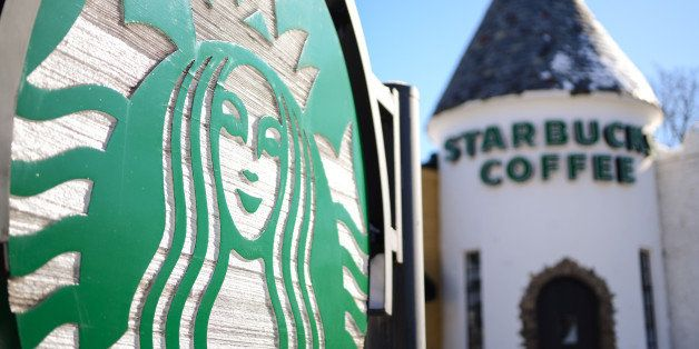 Starbucks Corp. signage is displayed outside a Starbucks location in Glen Rock, New Jersey, U.S., on Wednesday, Jan. 22, 2014