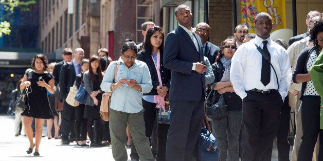 Job seekers line up outside at Choice Career Fairs' New York career fair at the Holiday Inn Midtown in New York, U.S., on Tue