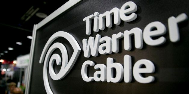 The Time Warner Cable Inc. logo is seen on the exhibit floor during the National Cable and Telecommunications Association (NC