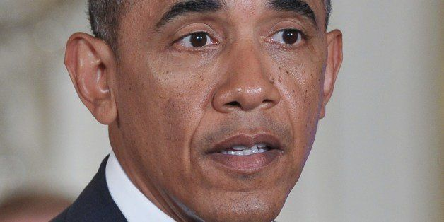 US President Barack Obama speaks before signing a memorandum on reducing the burden of student loans on June 9, 2014 in the E