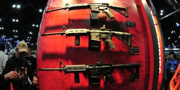 Various models of Bushmaster rifles are seen at the 142nd annual National Rifle Association(NRA) Convention at the George R. Brown Convention Center May 4, 2013 in Houston, Texas. AFP PHOTO / Karen BLEIER (Photo credit should read KAREN BLEIER/AFP/Getty Images)