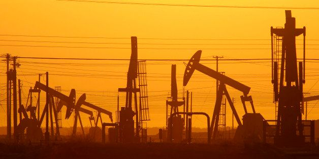 LOST HILLS, CA - MARCH 24:  Pump jacks are seen at dawn in an oil field over the Monterey Shale formation where gas and oil e