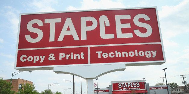 ELMWOOD PARK, IL - MAY 20:  A sign hangs outside a Staples store which is scheduled to close next month on May 20, 2014 in El